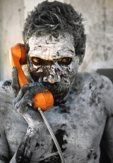 Penny Tweedie's remarkable1998 photo of an aboriginal elder using a telephone at invite clan members to a ceremony