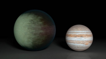 Kepler-7b (left), which is 1.5 times the radius of Jupiter (right), is the first exoplanet to have its clouds mapped. The cloud map was produced using data from NASA's Kepler and Spitzer space telescopes.