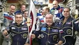 Sochi Olympic torch is held by Soyuz Commander Mikhail Tyurin at the International Space Station
