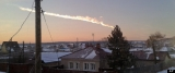 A meteor/asteroid contrail is seen over the village of Bolshoe Sidelnikovo, near Chelyabinsk, Russia
