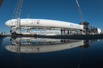 The Falcon 9 rocket and Dragon capsule are rolled out from the hangar in Cape Canaveral, Fla., headed to the launch pad.