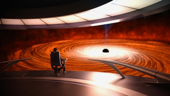 "Neil Tyson approaches a black hole in the TV show ""Cosmos"""