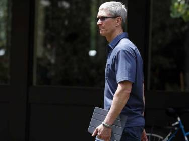 Apple CEO Tim Cook with iPad in tow