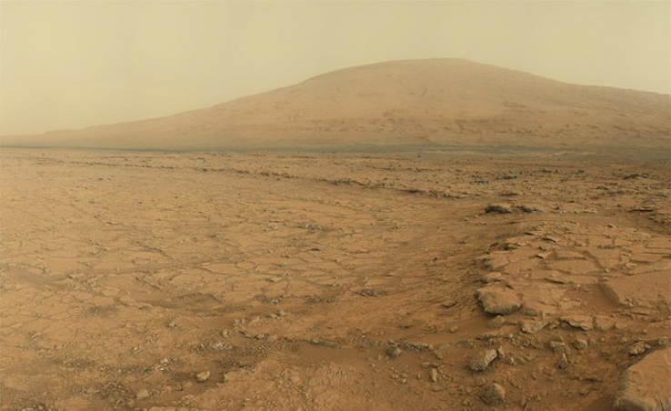 Panoramic view of the Martian surface as taken from the Curiosity rover: Mount Sharp is seen in the distance.