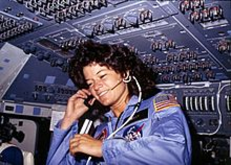 Sally Ride communicates with ground controllers from the flight deck during the six-day mission in Challenger, 1983