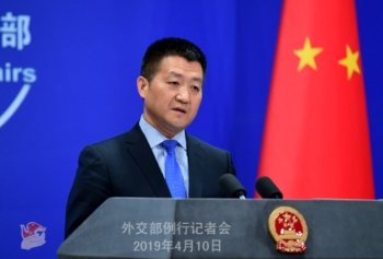 Lu Kang addressing the media during a regular press conference in Beijing on Wednesday.