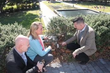 Newcastle City Mayor Nautili Nelmes, Smart City Coordinator James Vidler inspect the Newcastle smart water meter with NNNCo's CTO/COO Tony Tilbrook