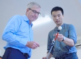 Dr Alastair Stott and Chen Zhu, IoT director at ThoughtWorks China, examine the SensaCane.