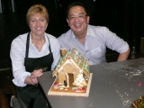 Infosys Senior Vice President and Country Head for Australia and New Zealand, Jackie Korhonen, with Peow Goh, formerly CIO of Rio Tinto, building gingerbread houses for disadvantaged members of the community in partnership with OzHarvest.