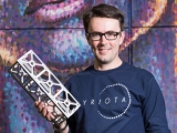 Myriota chief executive Dr Alex Grant holding a nanosatellite frame.