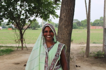 Radhika in India used a small loan from Opportunity International Australia to buy seeds and gardening equipment for farming, and to get money to send her children to school.
