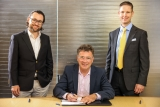 ASC agreement signing (from left): Deloitte Australia National Maritime Leader and Lead Engagement Partner, Jesse Sherwood;  ASC Chief Executive Officer and Managing Director, Stuart Whiley (seated) and IFS Australia and New Zealand Managing Director, Warren Zietsman