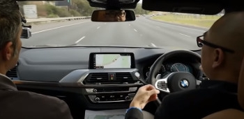 A vehicle with hands-free driving technology being tested.