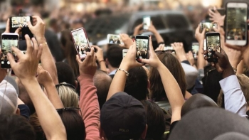 Crowds with smartphones on street